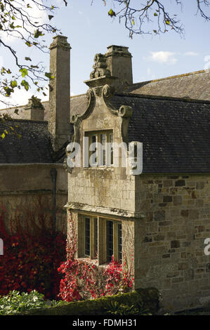 Dutch gable on the east front of the manor house, dated c.1570, at Trerice, Cornwall. - Stock Photo