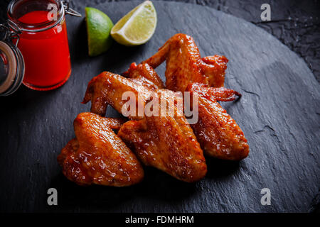 fried chicken wings on a black stone - Stock Photo