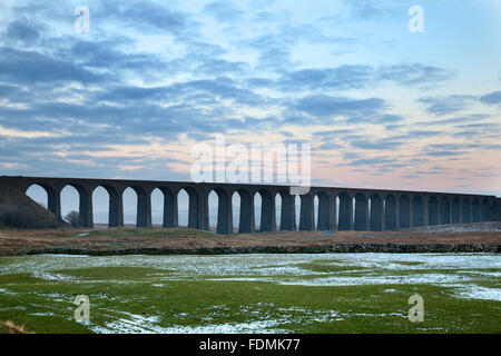 The Ribblehead Viaduct at Dusk in Winter Ribblehead Yorkshire Dales England - Stock Photo