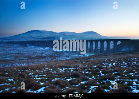 Ribblehead Viaduct and Park Fell Simon Fell and Ingleborough at Dusk Ribblehead Yorkshire Dales England - Stock Photo