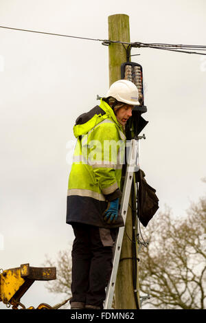 British Telecom engineer replacing a telegraph pole in Salisbury on a cold wintry day - Stock Photo