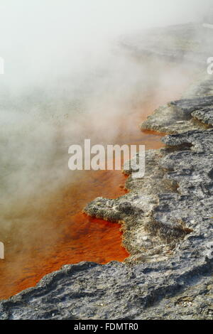 Champagne Pool in the stunning and amazing geothermal landscape of Wai-O-Tapu thermal area, Rotorua, New Zealand. - Stock Photo