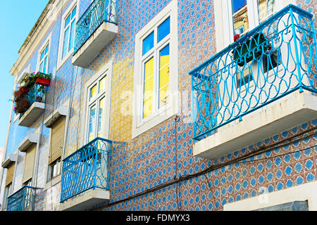 Lisbon building wall with balcony and traditional Portuguese tile - Stock Photo