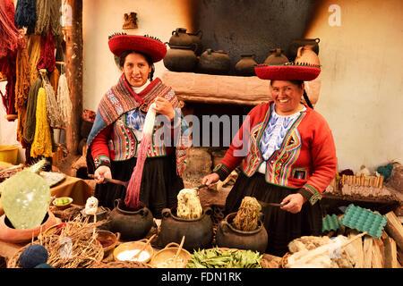 Two Peruvians, traditional alpaca wool dyeing, Chinchero, Cusco Province, Peru - Stock Photo
