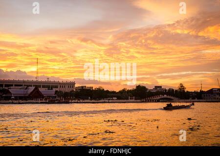 Bangkok, beautiful dramatic sunset on river Chao Phraya - Stock Photo