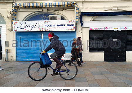 Seaside sweet shops shuttered up for the winter months, in Weston-super-Mare, North Somerset, UK. - Stock Photo