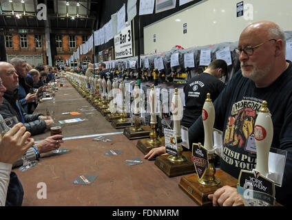 At the bar of the Manchester Central CAMRA winter beer festival 2016,Lancs,England, UK - Stock Photo