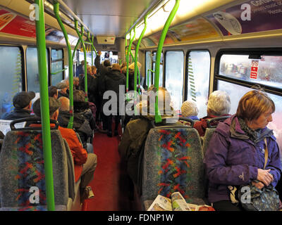 A busy public bus in Warrington,Cheshire,England,UK with passengers - Stock Photo