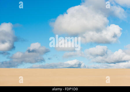Giant sand dunes of Te Paki with clouds in a blues sky, New Zealand - Stock Photo