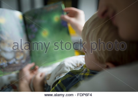 Close up mother and son reading book - Stock Photo