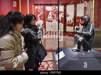 Beijing, China. 1st Feb, 2016. Visitors view an exhibit at the Capital Museum in Beijing, capital of China, Feb. - Stock Photo