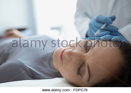 Woman receiving Botox injection - Stock Photo