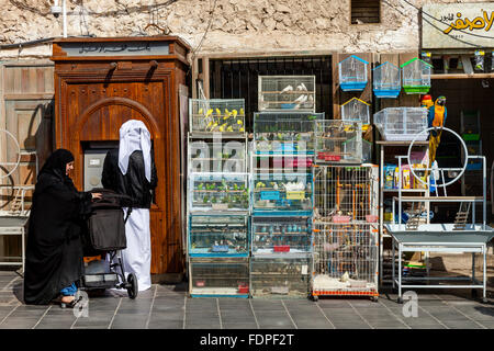 A Local Man Withdraws Money From A Cashpoint Machine, Souk Waqif, Doha, Qatar - Stock Photo