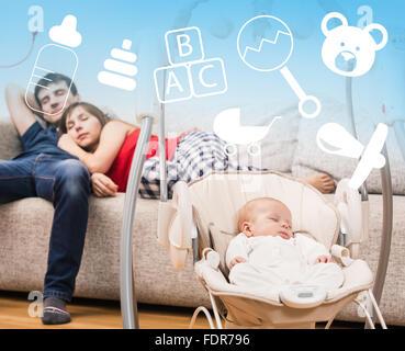 Newborn sleeping in baby swing - Stock Photo