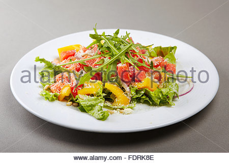 Stylised healthy salad   mixed greens, smoked salmon, tomatoes and paprica. Lots of copyspace - Stock Photo