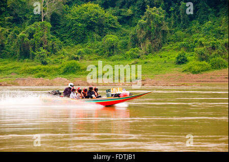 Speed boat transport on the Mekong River, between Laos and Thailand - Stock Photo