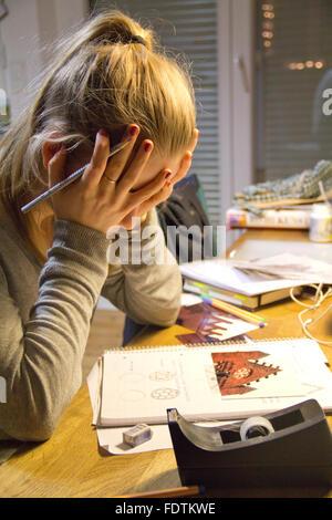 Berlin, Germany, girl doing homework - Stock Photo