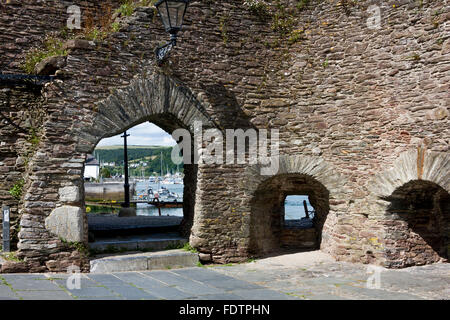 View Through Arched Entrance at Bayards Cove Fort and Canon Port of River Dart, Quay, Riverside Houses & Ferry; - Stock Photo