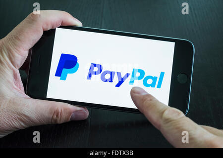 Logo of online banking app Paypal on screen of smart phone - Stock Photo