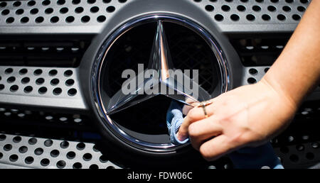 (FILE) - An archive picture, dated 23 September 2014, shows a fari assistant cleaning the Mercedes Benz logo of - Stock Photo