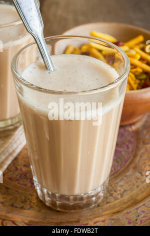 Masala Chai a refreshing blend of black tea with milk and spices - Stock Photo