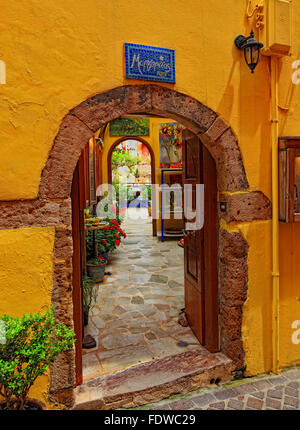 Crete, in the Old Town of Chania, archway, entrance to an inner courtyard - Stock Photo