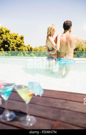 Happy couple in the pool - Stock Photo