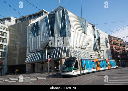 A Socimi Eurotram  passes the Printemps department store in Strasbourg France on a Sunday afternoon. - Stock Photo