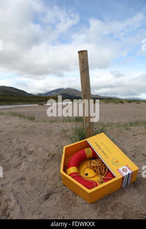 Red life bouy on a beach in Co. Kerry, Ireland - Stock Photo