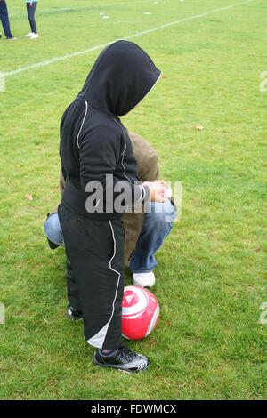 Playing a football match outside - Stock Photo