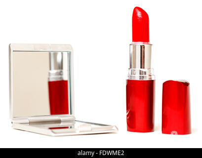 Bright red lipstick reflected in compact makeup mirror isolated on white background.  Model Release: No.  Property - Stock Photo