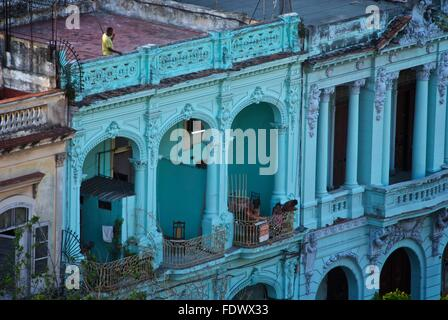 People on balconies in old Spanish colonial buildings in Havana, Cuba - Stock Photo