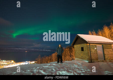 The Aurora Borealis - Northern lights dancing over Narvik In Norway - Stock Photo