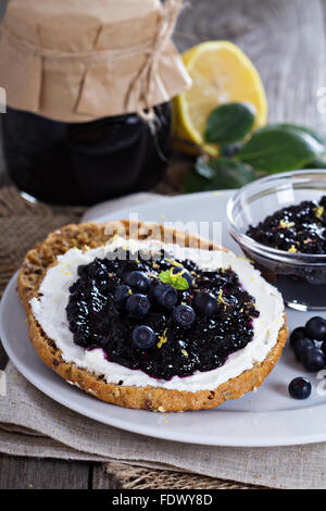 Blueberry jam with lemon zest on bread - Stock Photo