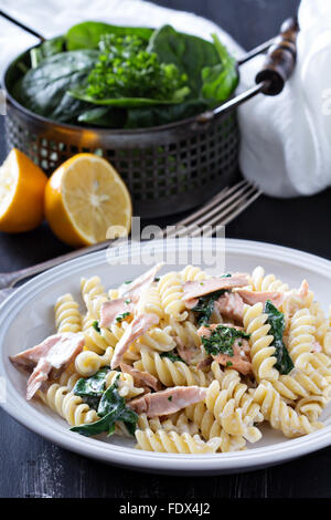 Pasta Fusilli With Baked Salmon Sour Cream And Spinach Stock Photo