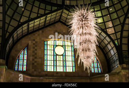 Magnificent Chandelier and stained-glass windows in the lobby of the Four Seasons Hotel Gresham Palace Budapest - Stock Photo