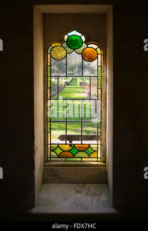 Stained glass window from inside the red house at painswick rococo gardens. Cotswolds, Gloucestershire, UK - Stock Photo