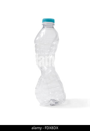 Studio shot of a crushed plastic water bottle - Stock Photo