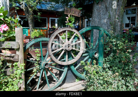 Old wagon wheels used to make an attractive fence at a heuriger wine restaurant in Kahlenberg, Vienna - Stock Photo
