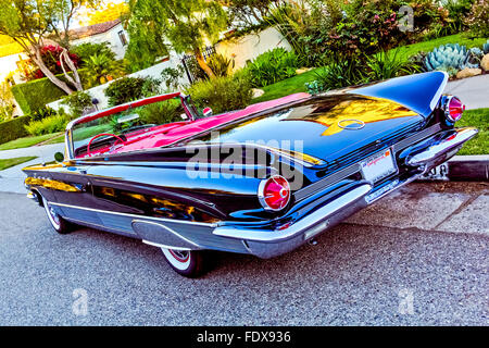 Classic American convertible black car with red leather interior parked in a street in California with red leather - Stock Photo