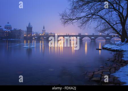 Twilight with the Charles Bridge, Prague, Czech Republic - Stock Photo