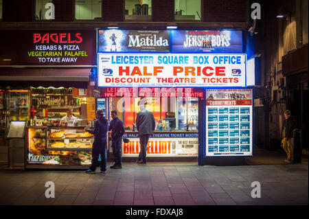 Leicester Square box office and bagel shop at night, London - Stock Photo