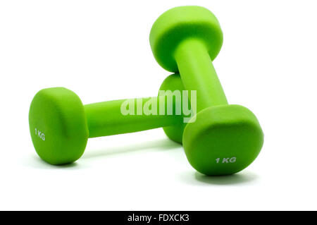 Isolated close up of two green bright dumbbells - Stock Photo