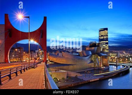 The Guggenheim museum next to Nervion river (ria del Nervion), Bilbao, Basque Country (Pais Vasco), Spain. - Stock Photo