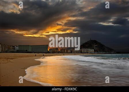 Sunset at playa de Gros (or Playa de la Zurriola). Donostia - San Sebastian, Basque Country, Spain. - Stock Photo