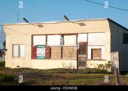 A neglected house for sale in the seaside village of Port Albert, South Gippsland, Victoria, Australia - Stock Photo