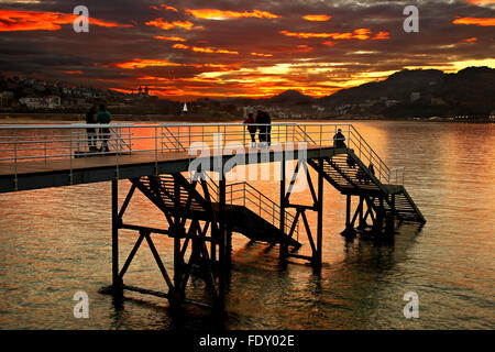 Sunset  in Donostia - San Sebastian, Basque Country, Spain. In the background to the right, Monte Igueldo. - Stock Photo