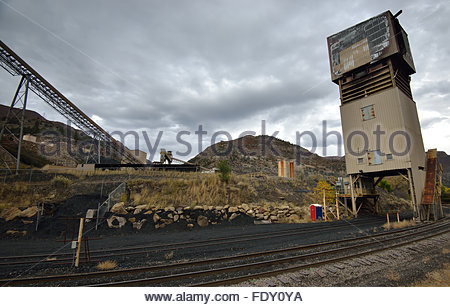 Train tracks in the foreground of an old coal mine near Somerset, Colorado on an overcast day - Stock Photo