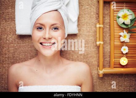 Happy girl enjoying aromatherapy - Stock Photo
