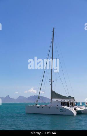 Yacht in harbour with Mo'orea in background, Pape'ete, Tahiti, French Polynesia - Stock Photo
